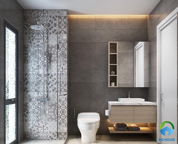 Ấn tượng với không gian nhà vệ sinh kết hợp giữa gạch bông màu xám và gạch xám trơn ốp tường