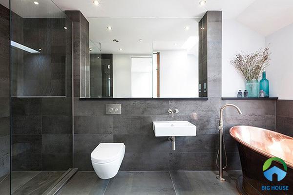 Trang trí nhà vệ sinh bằng gạch xám ốp tường mảng màu đậm nhạt tạo sự thu hút