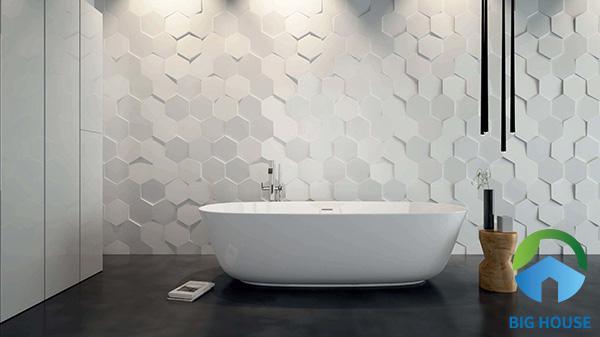 Những viên gạch men ốp tường chìm nổi tạo sự độc đáo cho không gian phòng tắm. Nó giúp ta liên tưởng đến những chiếc vảy cá tuyệt đẹp