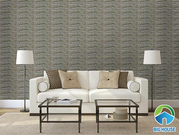 Gạch thẻ giả đá được sử dụng để ốp toàn bộ bức tường phòng khách tạo điểm nhấn